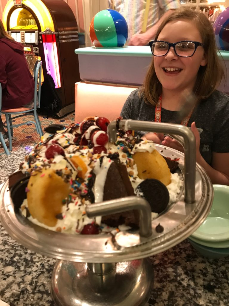 Teenage girl at Disney's Beaches & Cream with Kitchen Sink sundae