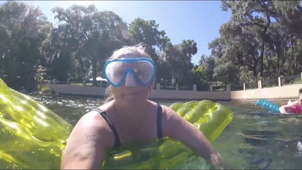 woman with snorkel mask on a pool float