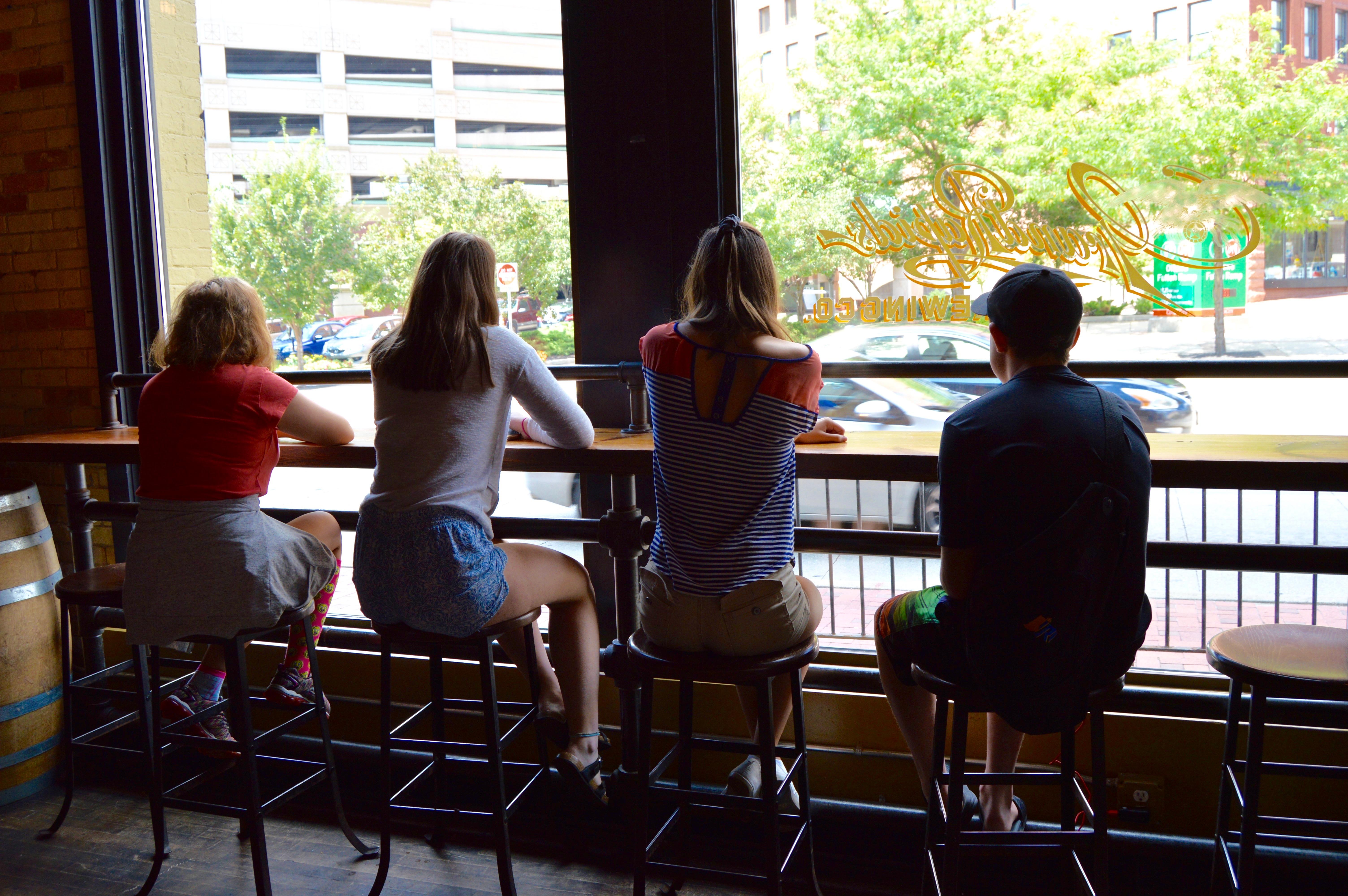 Kids sitting in window seats at Grand Rapids Brewing