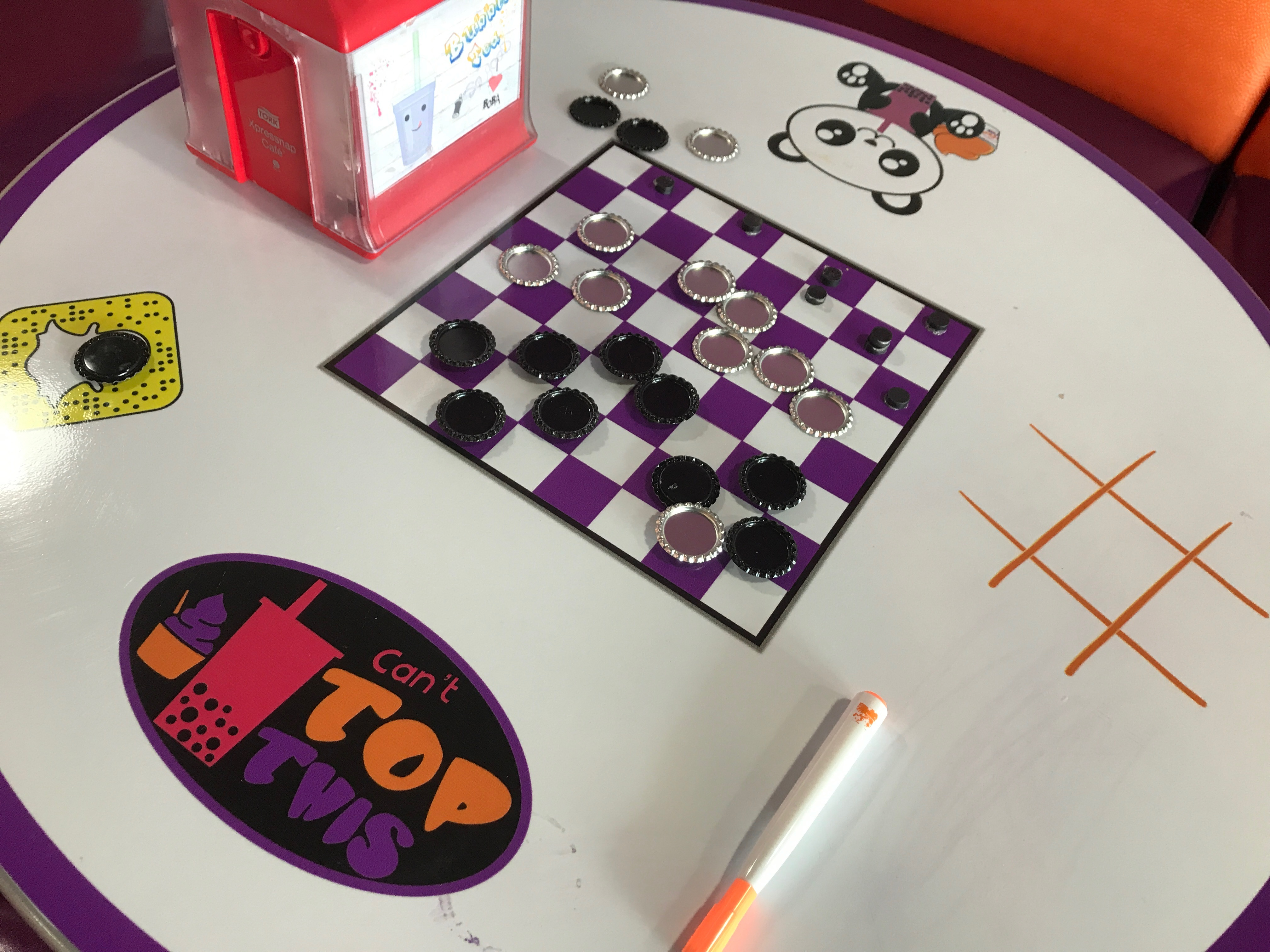 Table top with checkers and tic-tac-toe