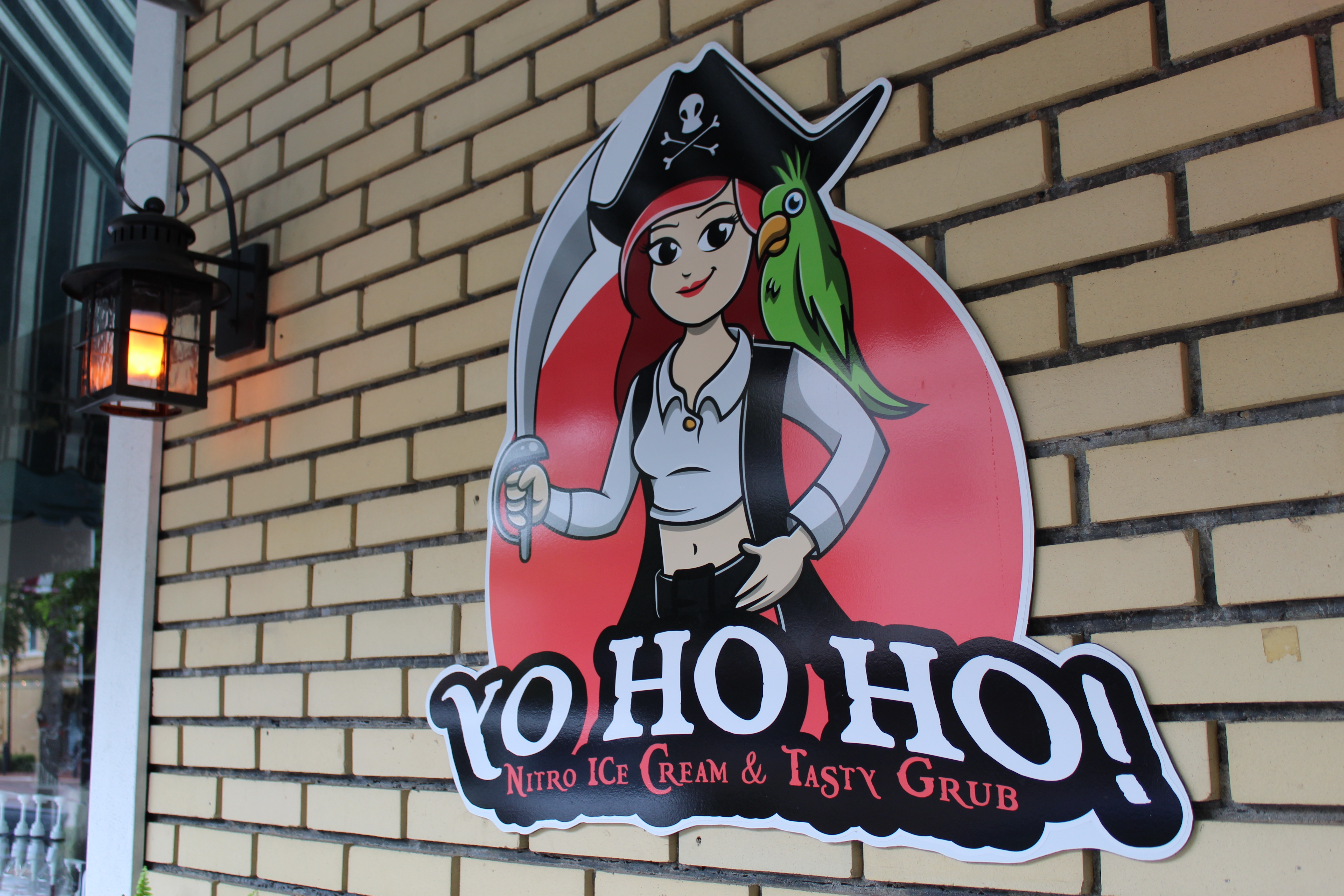 outdoor sign and logo for YoHoHo nitro ice cream & tasty grub