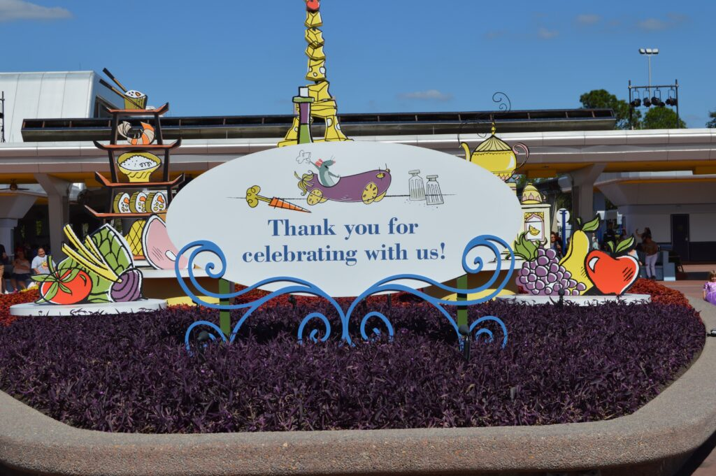 """Thank you for celebrating with us"" sign at Epcot Food & Wine Festival"