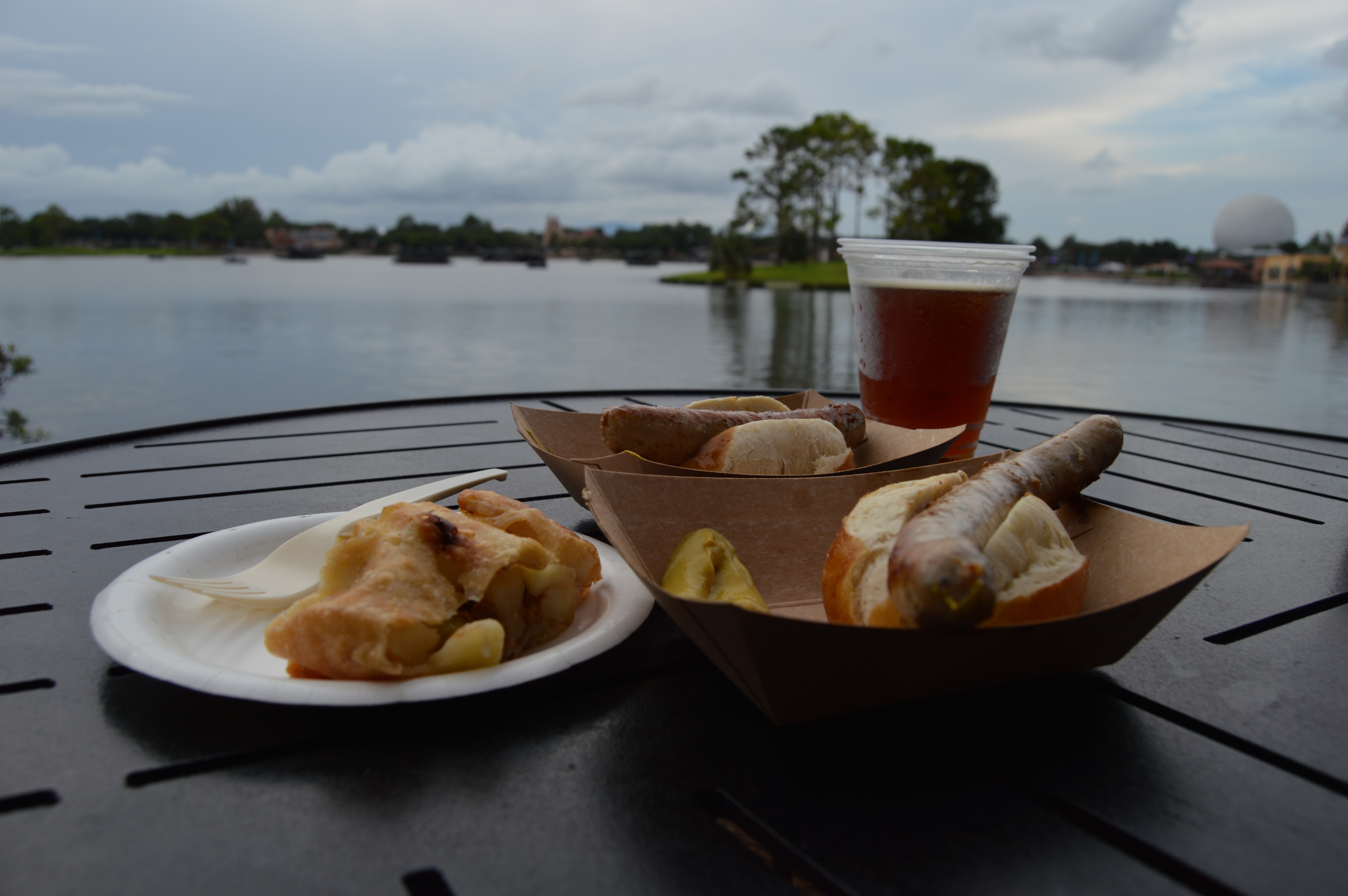 Apple strudel, brats on pretzel buns, and a glass of beer