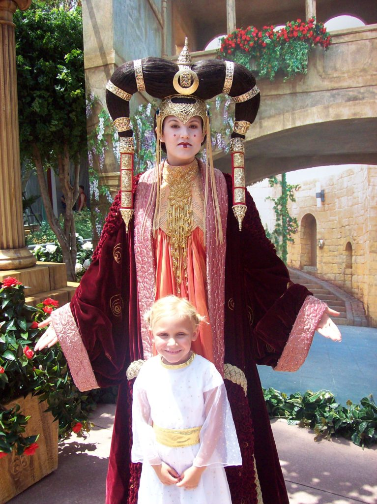 Little girl dressed as Princess Leia with Queen Amidala