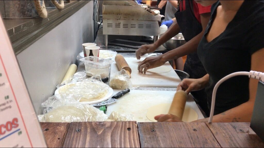 Cook making homemade tortillas at Papa Pineapples.