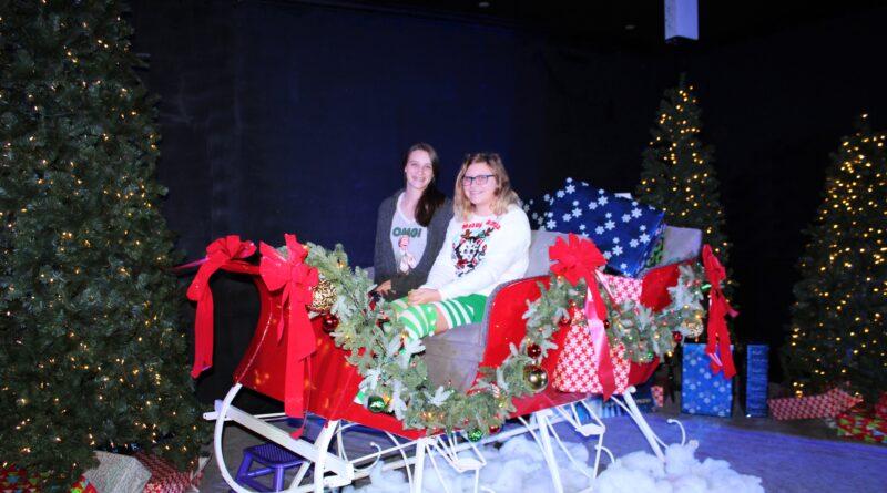 Teen girls in Santa Sleigh