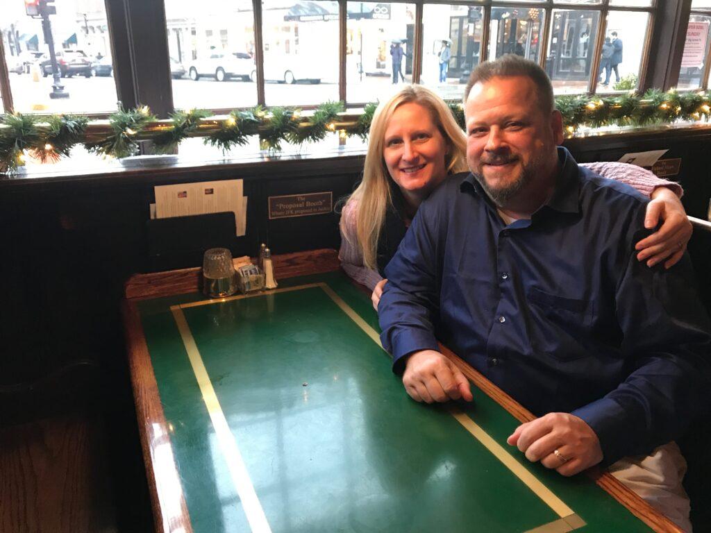 Couple sitting in proposal booth in Martin's Tavern Washington DC